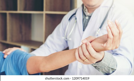 Doctor consulting with patient Shoulder problems Physical therapy diagnosing concept