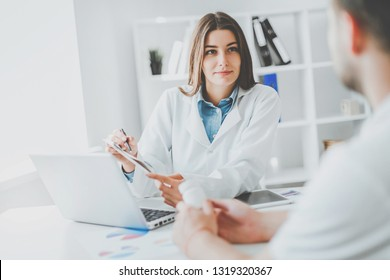 Doctor consulting patient. Patient sitting at doctor office. Diagnostic, prevention of diseases, healthcare, medical service, consultation or education.