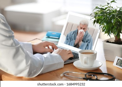Doctor consulting sick patient online by video chat in medical office, closeup