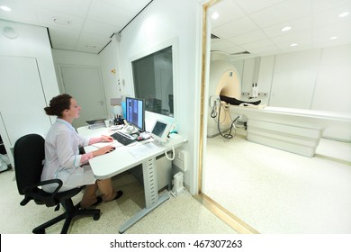 doctor in control room, and magnetic resonance imaging machine with patient