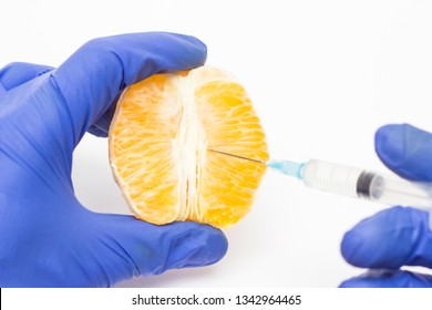 Doctor cosmetologist injects orange into the concept of the labioplasty procedure, reducing or increasing the correction of the labia of the woman s lips, intimate