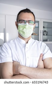 Doctor with crossed arms and mask