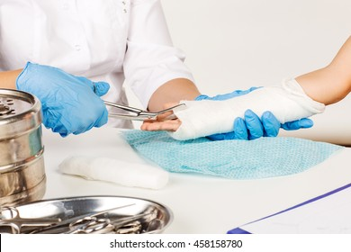 doctor cut bandage. medicine, health care and people concept
