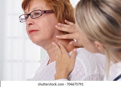 Doctor dermatologist examines birthmark of senior woman. Checking benign moles. Laser Skin tags removal