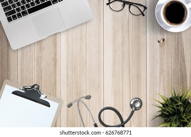 Doctor desk table with stethoscope, Laptop computer and eyeglasses, Top view
