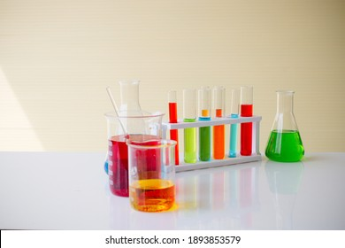 Doctor desk table withLabaratory glasses are located on table. Test tubes of various shapes. Multi-colored liquid is poured in test tubes. Concept - production of laboratory glassware. Laboratory glas