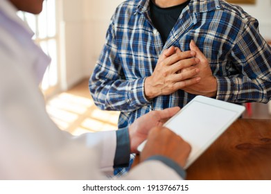 The doctor is diagnosing a male patient's chest pain. Concept of heart disease patients.