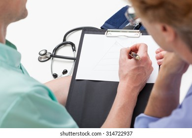 Doctor discussing with patient during medical consultation