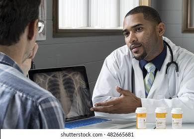 Doctor discussing prescription drugs with male patient