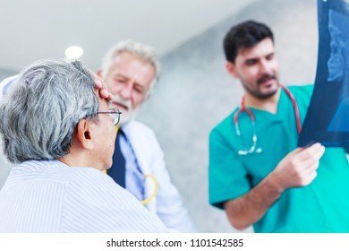 doctor discussing x-ray with Asian senior man patient in hospital