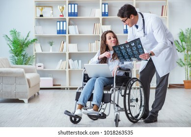 Doctor discussing x-ray image with patient