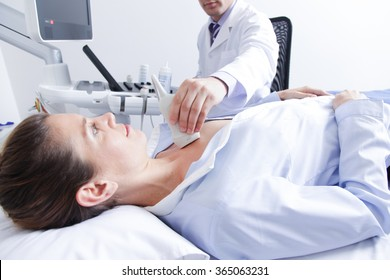 Doctor doing a doppler sonography