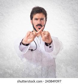 Doctor doing NO gesture over textured background