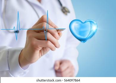 Doctor draws a cardiogram heart .