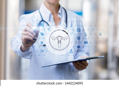 The doctor draws a treatment regimen of the female uterus on blurred background.