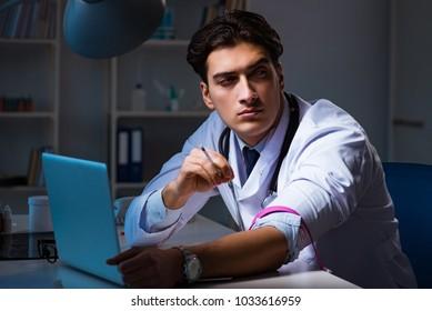 Doctor drug addict staying late on hospital