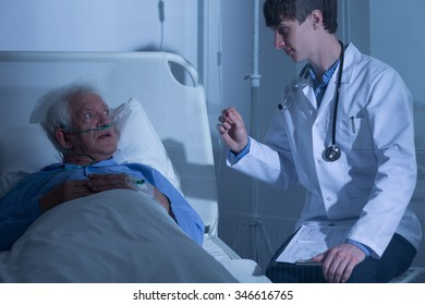Doctor and elderly patient in hospice care ward