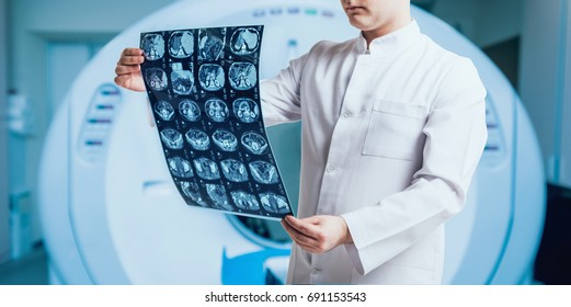 Doctor examine MRI picture. Medical equipment.
