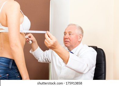 doctor examine woman breast measure with tape, plastic surgery
