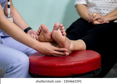 The doctor examines the nerve response with monofilament odiatrist treating feet during procedure. Doctor neurologist examining female patient .
