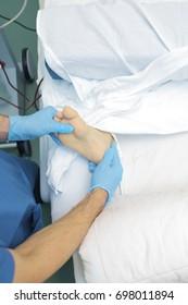 Doctor examines the patient's foot.