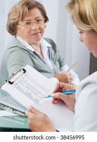 Doctor examines results of blood tests.  Selective focus  on clipboard with test results