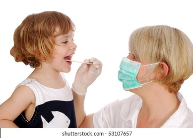 doctor examines throat in little girl patient