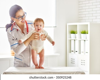 doctor examining a baby in a hospital