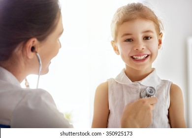doctor examining a child girl in a hospital