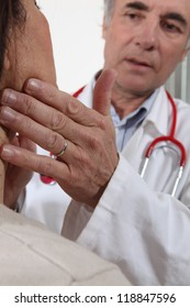 Doctor examining his patient's glands