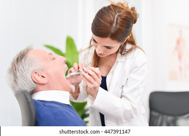Doctor examining a patient in her office