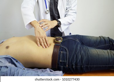 The doctor is examining the patient's stomach, abdominal pain, gastric ulcer, appendicitis.