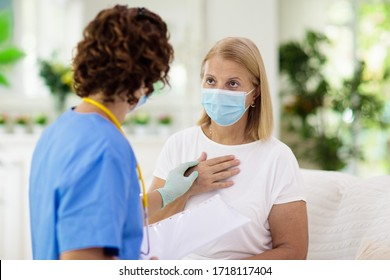 Doctor examining sick patient in face mask. Ill woman in health clinic for test and screening. Home treatment of virus. Coronavirus pandemic. Covid-19 outbreak. Woman coughing, having chest pain.