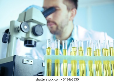 Doctor examining the urine in laboratory, closeup