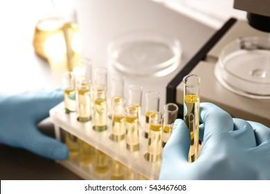 Doctor examining the urine in laboratory, closeup