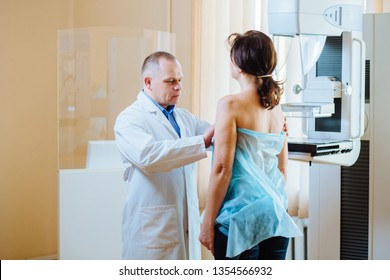 Doctor examining woman in hospital. Female patient listens to mammography technologist during survey. Explains importance of breast cancer prevention. Mammography procedure. Breast cancer awareness.