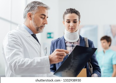 Doctor examining a young female patient's x-ray, she is wearing a cervical collar and having a serious neck injury