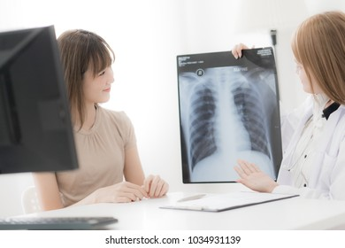 Doctor explaining diagnosis to her female patient. Asian people