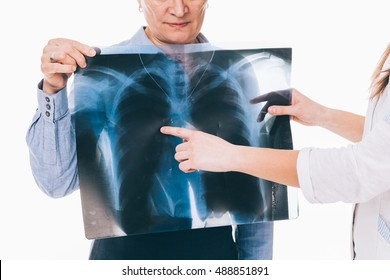Doctor explaining her patient the x-ray image results