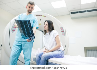 Doctor explaining leg MRI to a patient at hospital
