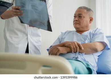 Doctor explaining result of radiography test to patient.