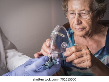 Doctor explains to old woman how ventimask inhalation training works, Andalusia, Spain
