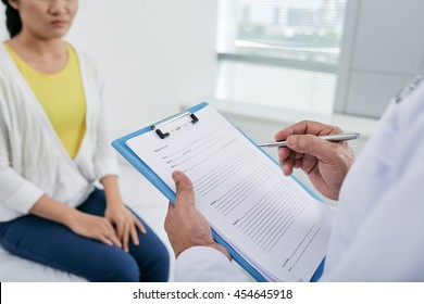 Doctor feeling medical history when talking to patient