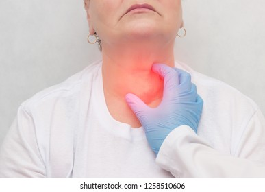Doctor feels the thyroid gland in a patient of an adult woman, thyroid cancer, close-up, node