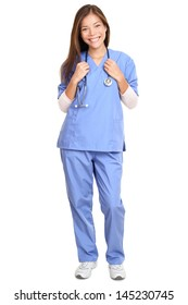 Doctor. Full length portrait of young female surgeon doctor or nurse with stethoscope around neck standing isolated on white background