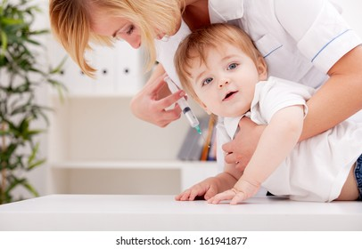 Doctor giving a child a huge injection in arm