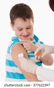 Doctor giving a child injection in arm on isolated image.