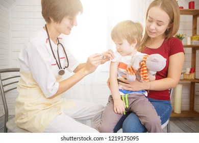 A doctor giving a child an injection at home.