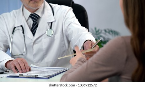 Doctor giving drug prescription to patient, qualified diagnosis and treatment
