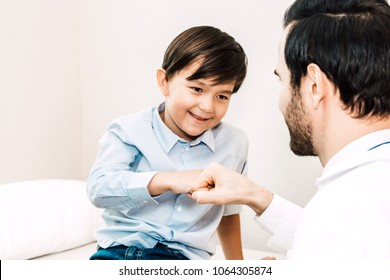 Doctor giving fist bump with patient boy in hospital.healthcare and medicine